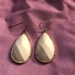 White earrings with gold trim